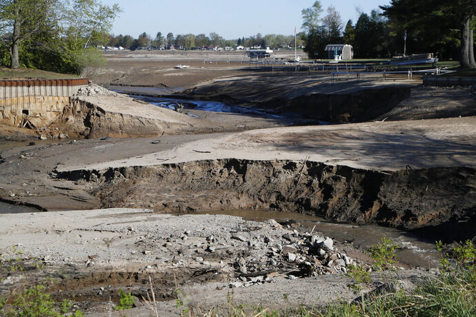 View of Wixom Lake, Thursday, May 21, 2020, after the water was drained after the Edenville Dam failed and flood waters rushed south, ravaging the landscape in its path, in Edenville Township, Mich. (AP Photo/Carlos Osorio)