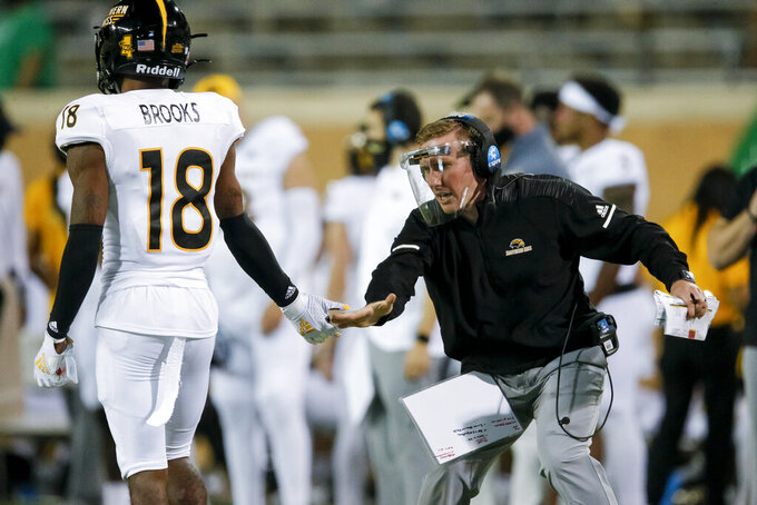 Southern Mississippi defensive back Natrone Brooks (18) is congratulated by interim head coach Scotty Walden after preventing a North Texas pass during the second half of an NCAA college football game on Saturday, Oct. 3, 2020, in Denton, Texas. (AP Photo/Brandon Wade)