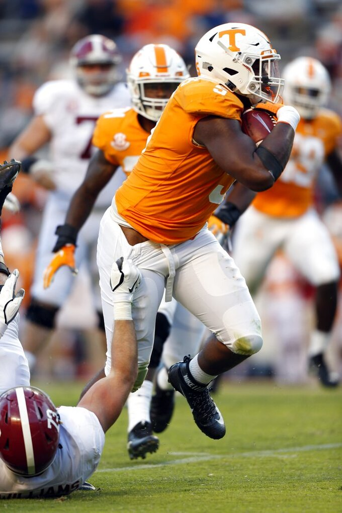 Tennessee defensive lineman Kyle Phillips (5) runs back an interception as Alabama offensive lineman Jonah Williams (73) tries to tackle him in the second half of an NCAA college football game Saturday, Oct. 20, 2018, in Knoxville, Tenn. Alabama won 58-21. (AP Photo/Wade Payne)