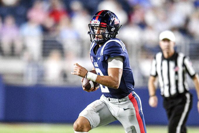 Mississippi quarterback Matt Corral (2) runs against Austin Peay during an NCAA college football game in Oxford, Miss., Saturday, Sept. 11, 2021. (AP Photo/Bruce Newman)