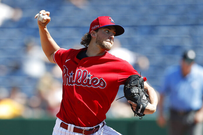 Philadelphia Phillies starting pitcher Aaron Nola throws during the third inning of a spring training baseball game against the Pittsburgh Pirates, Wednesday, March 4, 2020, in Clearwater, Fla. (AP Photo/Carlos Osorio)