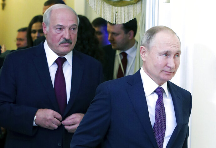 FILE In this file photo taken on Friday, Dec. 20, 2019, Russian President Vladimir Putin, right, and Belarusian President Alexander Lukashenko walk before a meeting of the Supreme Eurasian Economic Council in St. Petersburg, Russia. Russia has halted oil supplies to Belarus after the two countries failed to renegotiate a contract amid talks of further improving their economic ties. (Mikhail Klimentyev, Sputnik, Kremlin Pool Photo via AP, File)