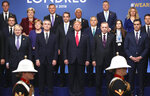 In this Dec. 4, 2019, photo, from front row left, British Prime Minister Boris Johnson, NATO Secretary General Jens Stoltenberg, U.S. President Donald Trump, Turkish President Recep Tayyip Erdogan and Spanish Prime Minister Pedro Sanchez attend a ceremony event during a NATO leaders meeting at The Grove hotel and resort in Watford, Hertfordshire, England. Three years into the Trump presidency, America's new place in the world is coming into focus, with influence waning from NATO meeting rooms to the Middle East to the capital cities of key allies. And in many ways, that's just fine with the White House.(AP Photo/Francisco Seco)