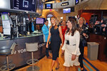 New York Stock Exchange President Stacey Cunningham, right, and first lady Melania Trump walk on the floor of the NYSE after ringing the opening bell in New York, Monday, Sept. 23, 2019. (AP Photo/Seth Wenig)