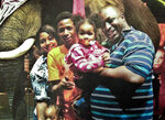FILE - In this undated family file photo provided by the National Action Network, Eric Garner, right, poses with his children during a family outing. Federal prosecutors won't bring civil rights charges against New York City police officer Daniel Pantaleo in the 2014 chokehold death of Eric Garner, a person familiar with the matter said Tuesday, July 16, 2019. The decision not to bring charges against Pantaleo comes a day before the statute of limitations was set to expire, on the fifth anniversary of the encounter that led to Garner's death.  (AP Photo/Family photo via National Action Network, File)