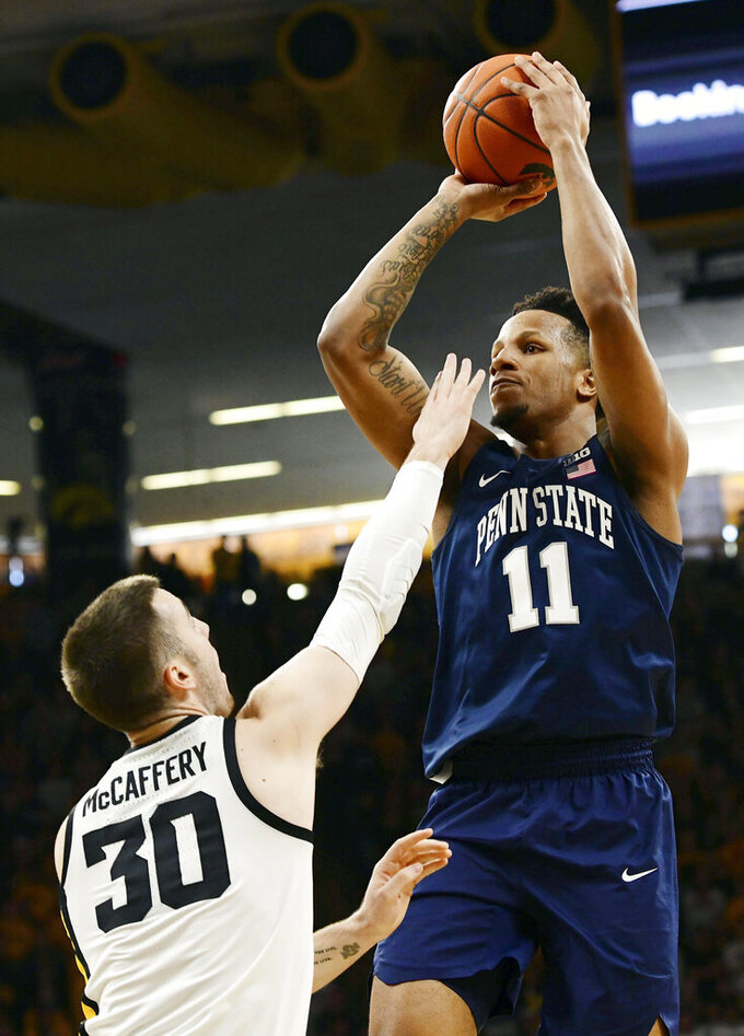 Penn State's Lamar Stevens (11) shoots over Iowa's Connor McCaffery (30) during the first half of an NCAA college basketball game, Saturday, Feb. 29, 2020, in Iowa City, Iowa. (AP Photo/Cliff Jette)