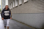 Igor Smirnov leaves a drug rehabilitation center in Tallinn, Estonia on Thursday, June 27, 2019. Smirnov was introduced to opiates the day his son was born, later migrating to a new drug that appeared on the quaint, cobbled streets of the country's capital, Tallinn: Fentanyl. (AP Photo/David Keyton)