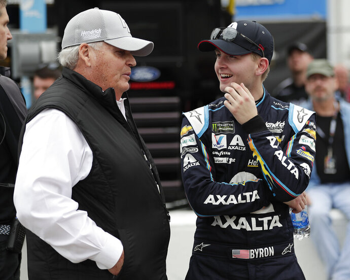 Car owner Rick Hendrick, left, talks with William Byron on pit road during qualifying for the Daytona 500 auto race at Daytona International Speedway, Sunday, Feb. 10, 2019, in Daytona Beach, Fla. (AP Photo/John Raoux)