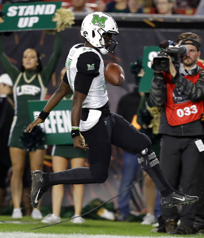 Marshall quarterback Isaiah Green (17) celebrates his 11-yard touchdown run against South Florida during the first half of the Gasparilla Bowl NCAA college football game Thursday, Dec. 20, 2018, in Tampa, Fla. (AP Photo/Chris O'Meara)