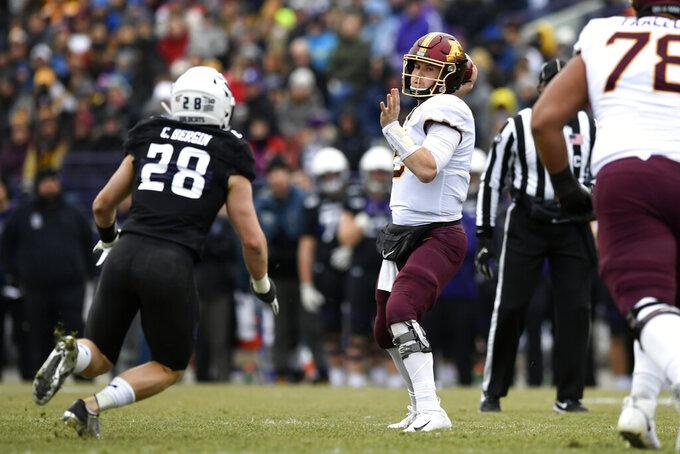 Minnesota quarterback Tanner Morgan (2) throws a pass against Northwestern linebacker Chris Bergin (27) during the first half of an NCAA football game Saturday, Nov. 23, 2019, in Evanston, Ill. (AP Photo/Paul Beaty)