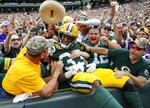 Green Bay Packers' Aaron Jones celebrates his touchdown run during the first half of an NFL football game against the Minnesota Vikings Sunday, Sept. 15, 2019, in Green Bay, Wis. (AP Photo/Matt Ludtke)