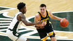 Iowa guard Joe Wieskamp (10) drives on Michigan State guard Rocket Watts (2) in the first half of an NCAA college basketball game in East Lansing, Mich., Saturday, Feb. 13, 2021. (AP Photo/Paul Sancya)
