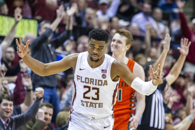 Florida State guard M.J. Walker (23) celebrates a 3-point shot in the first half of an NCAA college basketball game against Miami in Tallahassee, Fla., Saturday, Feb. 8, 2020. (AP Photo/Mark Wallheiser)