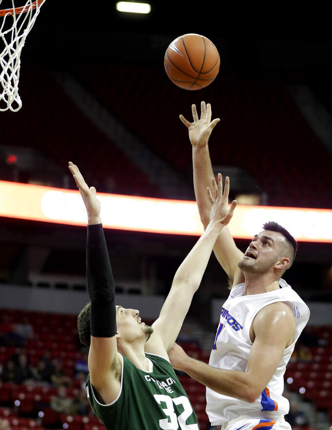 Boise State's Zach Haney, right, shoots over Colorado State's Nico Carvacho (32) during the first half of an NCAA college basketball game in the Mountain West Conference tournament, Wednesday, March 13, 2019, in Las Vegas. (AP Photo/Isaac Brekken)