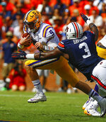 LSU quarterback Joe Burrow (9) carries the ball past Auburn defensive lineman Marlon Davidson (3) for the first down during the first half of an NCAA college football game, Saturday, Sept. 15, 2018, in Auburn, Ala. (AP Photo/Butch Dill)