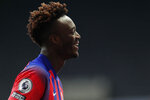 Chelsea's Tammy Abraham smiles at the end of the English Premier League soccer match between Newcastle United v Chelsea at the St. James' Park in Newcastle, England, Saturday, Nov. 21, 2020. (Lee Smith/ Pool via AP)