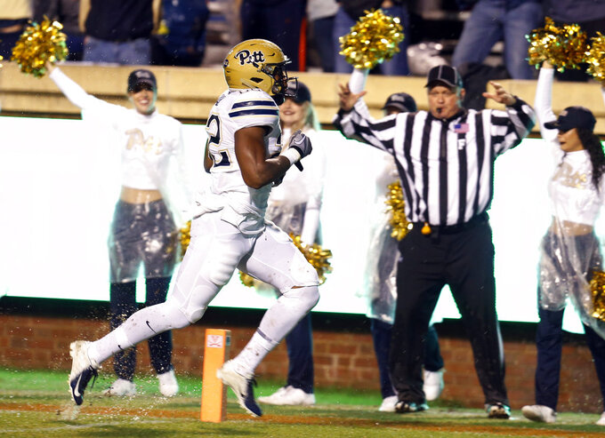 Pittsburgh running back Darrin Hall crosses the goal line for a touchdown during the first half against Virginia in an NCAA college football game in Charlottesville, Va., Friday, Nov. 2, 2018. (AP Photo/Steve Helber)