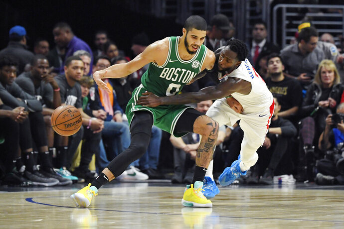 Los Angeles Clippers guard Patrick Beverley, right, reaches in on Boston Celtics forward Jayson Tatum during the second half of an NBA basketball game Wednesday, Nov. 20, 2019, in Los Angeles. (AP Photo/Mark J. Terrill)