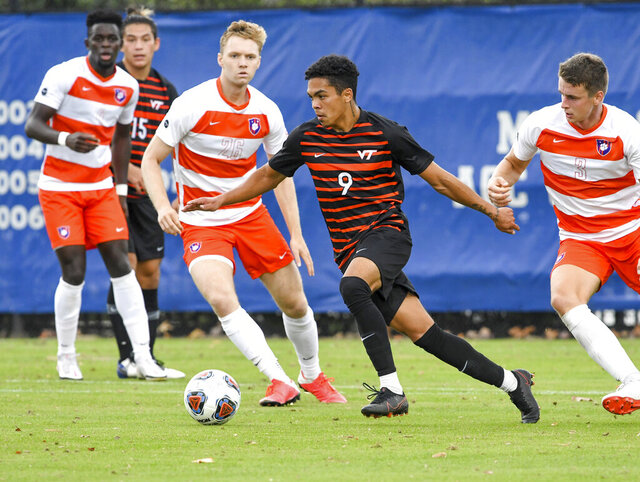 FILE - In this Nov. 15, 2020, file photo, provided by VTAthletics, Virginia Tech's Daniel Pereira dribbles the ball during an NCAA college soccer game against Clemson in Durham, N.C. Austin FC, The newest MLS franchise selected the talented Virginia Tech midfielder Daniel Pereira with the top pick in the league's SuperDraft on Thursday, Jan. 21, 2021.  (Dave Knachel/VTAthletics via AP, File)
