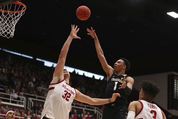 Colorado forward Tyler Bey (1) shoots against Stanford forward Lukas Kisunas (32) during the first half of an NCAA college basketball game in Stanford, Calif., Sunday, March 1, 2020. (AP Photo/Jed Jacobsohn)
