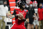 Cincinnati quarterback Desmond Ridder (9) runs out of the pocket against Georgia during the first half of the Peach Bowl NCAA college football game, Friday, Jan. 1, 2021, in Atlanta. (AP Photo/Brynn Anderson)