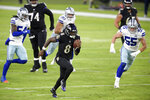 Baltimore Ravens quarterback Lamar Jackson (8) runs with the ball while scoring a touchdown on a keeper against the Dallas Cowboys during the first half of an NFL football game, Tuesday, Dec. 8, 2020, in Baltimore. (AP Photo/Nick Wass)
