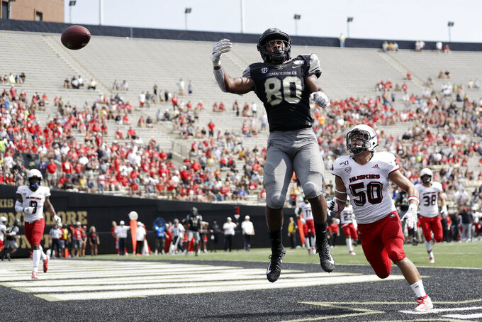 Vanderbilt tight end Jared Pinkney (80) reaches for a pass as he is defended by Northern Illinois linebacker Vinny Labus (50) in the second half of an NCAA college football game Saturday, Sept. 28, 2019, in Nashville, Tenn. Vanderbilt won 24-18. (AP Photo/Mark Humphrey)