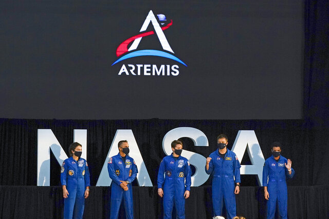 Five of the astronauts that will be part of the Atremis missions, from left, Jessica Meir, Joe Acaba, Anne McClain, Matthew Dominick, and Jessica Watkins are introduced by Vice President Mike Pence during the eighth meeting of the National Space Council at the Kennedy Space Center Wednesday, Dec. 9, 2020, in Cape Canaveral , Fla. (AP Photo/John Raoux)