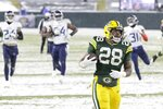 Green Bay Packers' A.J. Dillon runs for a touchdown during the second half of an NFL football game against the Tennessee Titans Sunday, Dec. 27, 2020, in Green Bay, Wis. (AP Photo/Mike Roemer)