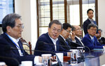 South Korean President Moon Jae-in, second from left, speaks during a meeting with his aids at the presidential Blue House in Seoul, South Korea, Monday, April 15, 2019. Moon says he's ready for a fourth summit with North Korean leader Kim Jong Un to help salvage faltering nuclear negotiations between Washington and Pyongyang. (Bee Jae-man/Yonhap via AP)