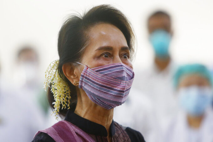 FILE - In this Jan. 27, 2021, file photo, Myanmar leader Aung San Suu Kyi watches the vaccination of health workers at a hospital in Naypyitaw, Myanmar. Myanmar's detained former leader, Suu Kyi, was unable to attend a scheduled court hearing Monday, Sept. 13, 2021, because she felt ill, her lawyers said. She is being tried in the capital Naypyitaw on charges of sedition - defined as spreading information that could cause public alarm or unrest - as well as two counts of flouting COVID-19 pandemic restrictions during the 2020 election campaign. (AP Photo/Aung Shine Oo, File)