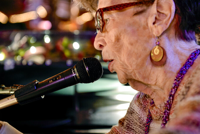 Patricia Sponheim, better known as Piano Pat, performs on Jan. 31, 2018, at the Sip n Dip in Great Falls, Mont. Sponheim, who entertained crowds at a tiki bar in downtown Great Falls for more than 50 years, died Tuesday, May 4, 2021, according to a notice by Schneider Funeral Home. She was 86. (Rion Sanders/The Great Falls Tribune via AP)