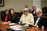 David Turpin, second from right, and wife, Louise, far left, listen to their charges as they are joined by their attorneys, Allison Lowe, second from left, and David Macher in a courtroom Friday, Feb. 22, 2019, in Riverside, Calif. The California couple who shackled some of their 13 children to beds and starved them pleaded guilty Friday to torture and other abuse in a case dubbed a