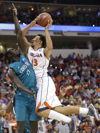 APTOPIX NCAA Coastal Carolina Virginia Basketball