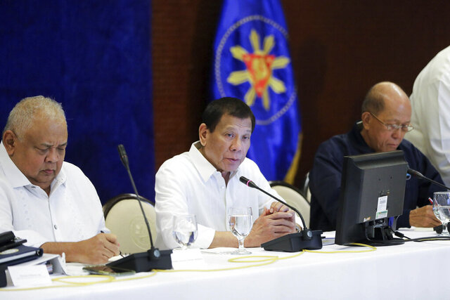 In this Jan. 7, 2020, photo provided by the Malacanang Presidential Photographers Division, Philippine President Rodrigo Duterte, center, talks during the Joint Armed Forces of the Philippines-Philippine National Police (AFP-PNP) Command Conference at the Malacanang presidential palace in Manila, Philippines. The Philippine government has ordered the mandatory evacuation of Filipino workers from Iraq and is sending a coast guard vessel to the Middle East to rapidly ferry its citizens to safety in case hostilities between the United States and Iran worsen, officials said Wednesday. (Alfred Frias/ Malacanang Presidential Photographers Division via AP)