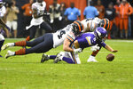 Minnesota Vikings quarterback Kirk Cousins (8) fumbles as he is sacked by Chicago Bears inside linebacker Nick Kwiatkoski, left, while Bears outside linebacker Leonard Floyd gets in on the play during the second half of an NFL football game Sunday, Sept. 29, 2019, in Chicago. The Vikings kept possession of the ball.(AP Photo/Matt Marton)