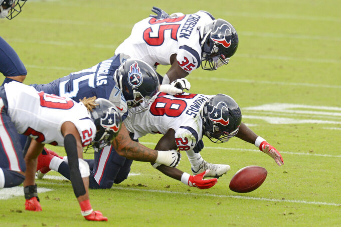 Houston Texans' Michael Thomas (28) recovers a blocked field goal attempt by the Tennessee Titans in the second half of an NFL football game Sunday, Oct. 18, 2020, in Nashville, Tenn. (AP Photo/Mark Zaleski)