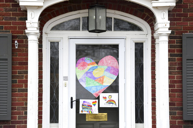 Houses near McKennan Park display teddy bears in their windows to create a scavenger hunt for kids home from school on Wednesday, March 25, in Sioux Falls  (Erin Bormett/The Argus Leader via AP)