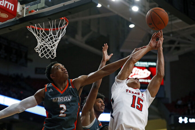 Texas-Rio Grande Valley's Quinton Johnson II (2) knocks the rebound away from Texas Tech's Kevin McCullar (15) during the second half of an NCAA college basketball game Saturday, Dec. 21, 2019, in Lubbock, Texas. (AP Photo/Brad Tollefson)
