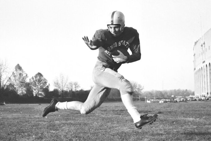 "FILE - This 1953 file photo, shows Ohio State halfback Howard ""Hopalong"" Cassady in action pose in Columbus, Ohio. Cassady, a Heisman Trophy winner and former NFL running back, died early Friday, Sept. 20, 2019, in Tampa, Fla.,  Jerry Emig, the Ohio State associate athletic director said. He was 85. Cassady played both football and baseball at Ohio State in the early 1950s, winning the Heisman Trophy in 1955. He also played 10 seasons in the NFL, mostly with the Detroit, and got the nickname ""Hopalong"" from local sports writers after the black-hatted Western star of the 1950s. (AP Photo/Harold Valentine, File)"