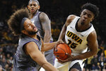 Iowa forward Tyler Cook gets fouled by Northwestern center Barret Benson, left, while driving to the basket during the second half of an NCAA college basketball game, Sunday, Feb. 10, 2019, in Iowa City, Iowa. Iowa won 80-79. (AP Photo/Charlie Neibergall)