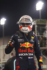 Red Bull driver Max Verstappen of the Netherlands celebrates the qualifying for the Bahrain Formula One Grand Prix, at the Formula One Bahrain International Circuit in Sakhir, Bahrain, Saturday, March 27, 2021. The Bahrain Formula One Grand Prix will take place on Sunday. (Lars Baron, Pool via AP)