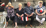 In this Saturday June 20, 2020 photo Antoni Kryszylo, a 74-year-old retired taxi driver, second from right, waits with other town people to hear Polish President Andrzej Duda at a campaign rally in Bialystok, Poland. Kryszylo adores Duda so much he wishes he could