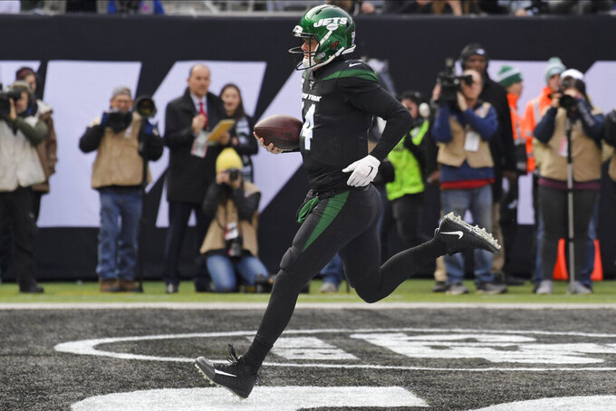 New York Jets quarterback Sam Darnold (14) rushes for a touchdown during the first half of an NFL football game against the New York Giants, Sunday, Nov. 10, 2019, in East Rutherford, N.J. (AP Photo/Bill Kostroun)