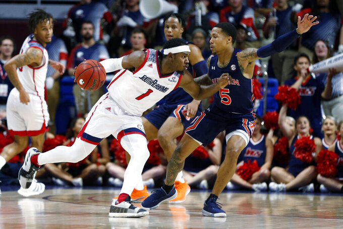 South Alabama guard Herb McGee (1) tries to get around Auburn guard J'Von McCormick (5) during the first half of an NCAA college basketball game, Tuesday, Nov. 12, 2019, in Mobile, Ala. (AP Photo/Butch Dill)