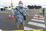 Gary Dohman, 81, from San Clemente Calif., who suffers from lung cancer, walks with an Oxygen machine, after getting a vaccine at the Disneyland Resort serving as a Super POD (Point Of Dispensing) COVID-19 mass vaccination site Wednesday, Jan. 13, 2021, in Anaheim, Calif. California is immediately allowing residents 65 and older to get scarce coronavirus vaccines, Gov. Gavin Newsom announced Wednesday. (AP Photo/Damian Dovarganes)