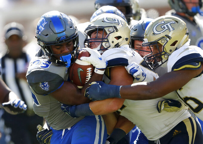 Duke running back Deon Jackson (25) is stopped by Georgia Tech linebacker Brant Mitchell, center,  and defensive back Malik Rivera (36), right, during the second half of an NCAA college football game, Saturday, Oct. 13, 2018, in Atlanta. Duke won 28-14. (AP Photo/John Bazemore)