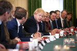 FILE - In this file photo dated Tuesday, Dec. 17, 2019, Britain's Prime Minister Boris Johnson speaks during his first cabinet meeting since the general election, inside 10 Downing Street in London, Tuesday, Dec. 17, 2019.  After a remarkable political turnaround, Prime Minister Boris Johnson is on the verge of taking Britain out of the European Union during 2020 with the enthusiastic support of a strong majority in Parliament. (AP Photo/Matt Dunham, File)