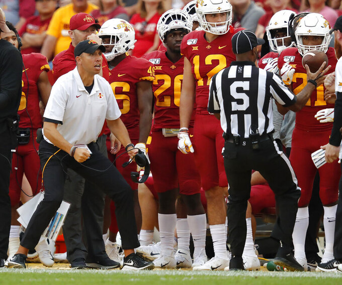 RETRANSMISSION TO CORRECT DATE - Iowa State head coach Matt Campbell, left, looks to an official for a facemask penalty against Louisiana-Monroe on the sidelines during the first half of an NCAA college football game, Saturday, Sept. 21, 2019, in Ames. (AP Photo/Matthew Putney)