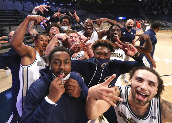 Georgia Tech celebrates a win over Clemson in an NCAA college basketball game Wednesday, Jan. 20, 2021, in Atlanta. (Curtis Compton/Atlanta Journal Constitution via AP, Pool)